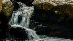 Small waterfall focus pull and dolly push in Stock Footage