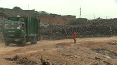Geen rubbish truck backs toward dump Stock Footage