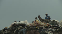 Human figures on top of waste mountain Stock Footage