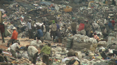 Human scavengers scurry on Lagos city wast dump Stock Footage