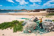 Stock Photo of nets on the punta del diablo beach, popular tourist place and fisherman's pla