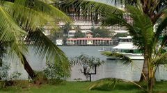 Stock Video Footage of India Kerala Kochi Cochin City 049 boat between palm leaves