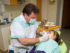 Dentist and little girl Stock Photos