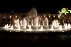 Dancing Multi Colored fountain at dark night Stock Photos