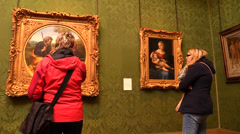 Women are arguing about a painting in art gallery - stock footage