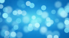 Shiny blue defocused lights loopable background Stock Footage