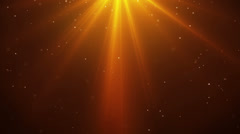 Falling sparkling particles and rays of orange light loopable Stock Footage