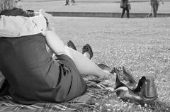 Couple in the Forties relaxing on the Park Kuvituskuvat