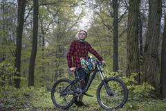Stock Photo of Bike Freeride in forest, Young man with moutain