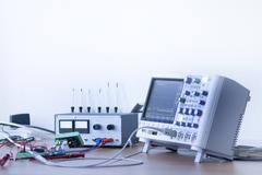 Electronic instruments of measurement in workshop - stock photo