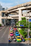 Multilevel bangkok with traffic on street and skytrain tracks Stock Photos