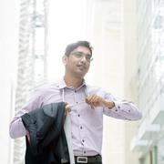 Indian businessman taking off his tie Stock Photos