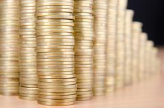Golden coins in high stacks Stock Photos