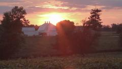 Barn sunset tilt up from foreground Stock Footage