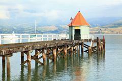 Akaroa jetty New Zealand Stock Photos