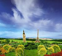 Big Ben and Eiffel tower in the countryside - stock illustration