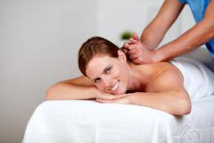 Young female getting a back massage by a masseuse Kuvituskuvat