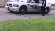 Stock Video Footage of Policeman at his vehicle