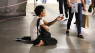 Stock Video Footage of Beggar men begging on the street in central Bangkok., Thailand