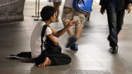 Stock Video Footage of Beggar man begging on the street in central Bangkok., Thailand