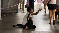 Beggar man begging on the street in central Bangkok., Thailand Stock Footage