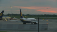 Stock Video Footage of Plane at sunset prepares for take off