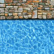 Irregular stone pavement with pool edge background Stock Photos