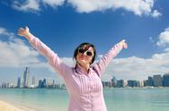 Stock Photo of happy tourist woman