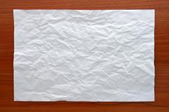 Wrinkled White paper attach on Wooden Board Stock Photos