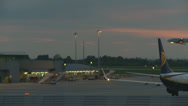 Stock Video Footage of Plane traffic at Stansted airport, sunset
