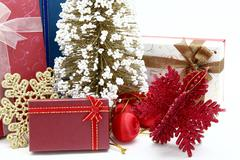Stock Photo of red holiday box with christmas tree and ornament