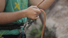 Man Securing Rock Climbing Stock Footage