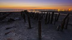 tidal defences at dusk - stock photo