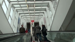 Visitors on escalator at Light and Sound exhibition Stock Footage