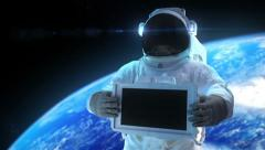 Astronaut with display - stock footage