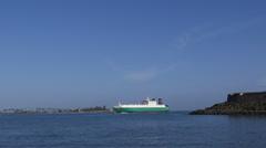 General car cargo ship vessel entering bay of San Juan Stock Footage