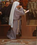 Nun praying inside the Basilica of Annunciation in Nazareth - stock photo