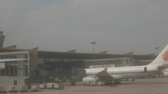 Plane preparing for flight at Beijing Capital International Airport Stock Footage