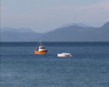 ERESFJORDEN, NORWAY: Small fishing boats anchored in fjord + zoom out + pan Stock Footage