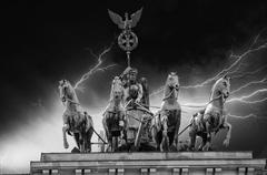 Stormy sky above Quadriga Monument in Brandenburg Gate - stock photo