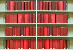 red old hardcover books - stock photo