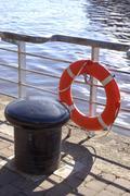 capstan and lifebelt - stock photo
