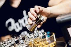 Poring a brandy Stock Photos