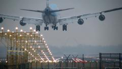 4K Jumbojet landing, airport lights Stock Footage
