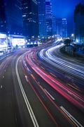 traffic in city at night in hong kong - stock photo