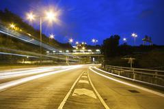modern urban city with freeway traffic at night, - stock photo