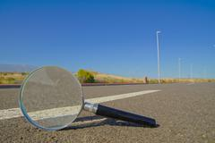 loupe on the road - stock photo