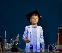 Inquisitive boy watching result of experiment - stock photo
