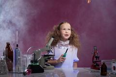 Image of pretty schoolgirl posing in chemistry lab - stock photo