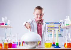 Adorable little boy watching reaction of reagent - stock photo
